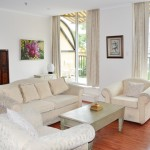 Premium 2BR Apartment at Regency Apartments has a lounge area opening onto a double balcony
